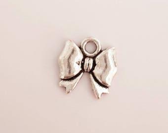 silver metal bow charm