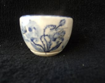 white earthenware cup poppy pattern, cobalt blue for tea, coffee