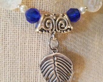 Ladies Swarovski crystal necklace with silver leaf motif