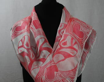 Handprinted silk scarf with red heart design.