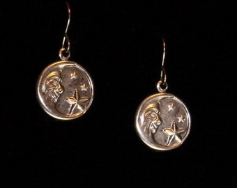 Man in moon earrings on hypoallergenic surgical steel ear wires