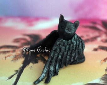 Black winged resin kitty