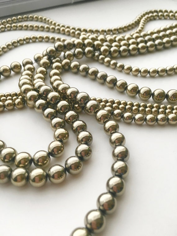 strand hematite smooth beads beadkraft round wholesale