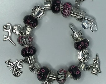 Cat themed charm bracelet in pink and black