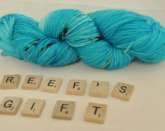 "Hand-dyed yarn, ""Reef's Gift"" variegated, soft and squishy yarn. Great for socks or shawls. 80/20 Superwash wool/Nylon"