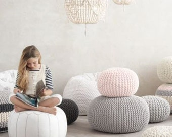 Super soft poufs made of knitted ribbon yarn. Cozy poufs for the interior. Knitted poof. Soft furniture.