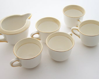 5 coffee cups and creamer white and beige earthenware cups and milk pot, Salins earthenware vintage Made in France