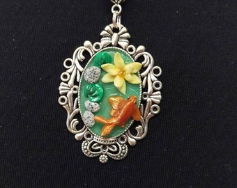 Gold fish and lotus flower pendant