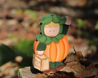 child in pumpkin costume