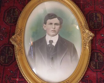 Antique Oval Wood Victorian Gold Gilded Frame Convex Glass Tinted Portrait of Man in Suit Early 1900s