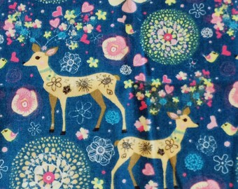 Beautiful multi coloured cotton linen fabric with deer, flowers and hearts on a dark blue background per fat quarter / per half metre