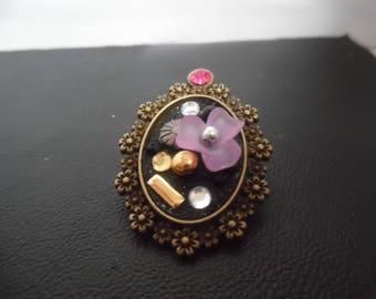 Cameo flower brooch and rhinestones