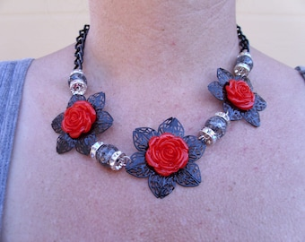Black flower filagree with bright red rose cabachon, smoked crystal beads, rondelles, matching earrings