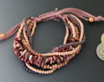 Multi-strand bracelet with macrame sliding knot. One size fits most. Pink and purple and copper jewelry.