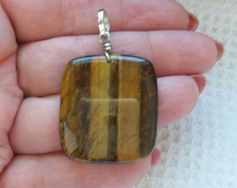 Handmade pendant in natural tiger eye on silver 925