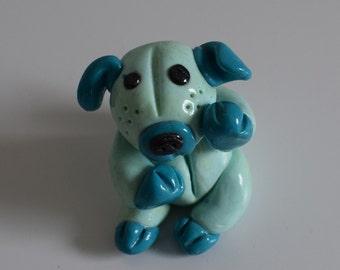 Blue fancy dog. 5.5 cm. Option of Magnet, photo holder, or key ring for this item.