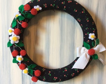 Wreath with red cherries