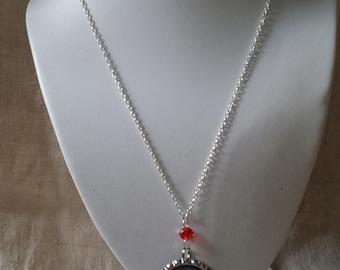 """eye in a pod"" necklace"