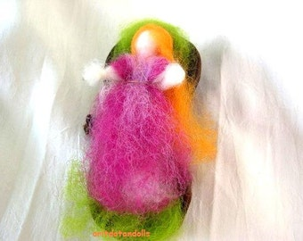Wool fairy sleeping in a dried fruit pod made in needle felted soft sculpture,  Waldorf education