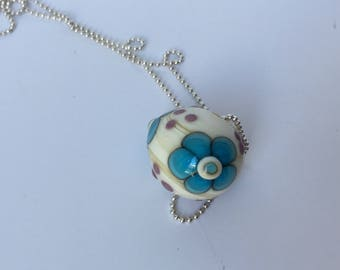 Ivory floral lampwork bead