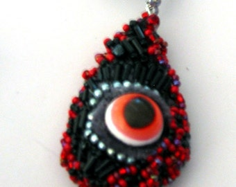 Red Beaded Crawling Eye Pendant