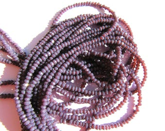 30 ROUND GLASS BEADS HAS FACETED PURPLE CHANGING AMBER 3MM