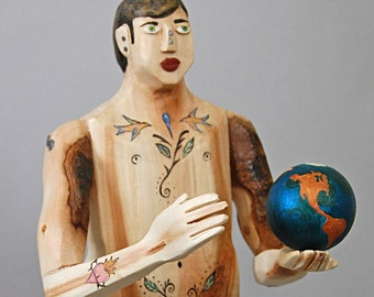 wood sculpture -   Earth and Man