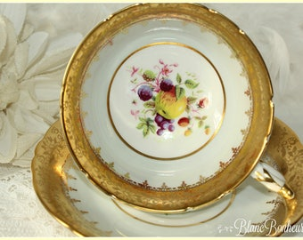 Paragon, England: Pastel blue tea cup & saucer with fruit and gold gilding