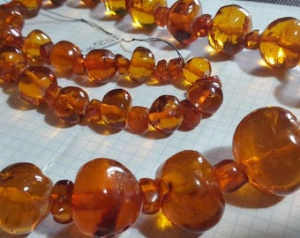 Large amber beads.