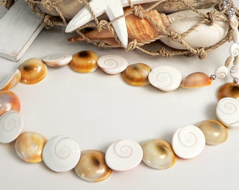 Cat's Eyes (Shiva Shells) and Sterling Silver Findings.