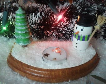 Snowy Christmas decoration with candle holder