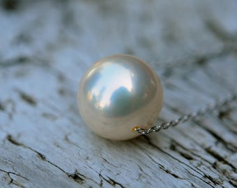 single floating pearl necklace, 12mm brilliant white pearl floating on a fine silver chain