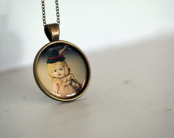 Photo Pendant Necklace of an Antique Porcelain Doll Named Claudia Wearing a Tiny Green Vintage Hat
