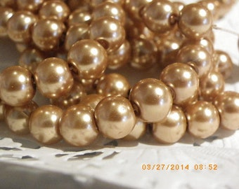 100 glass Pearl 8 mm with a beautiful golden beige beads