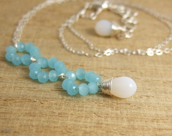 Necklace with Tiny, Aqua Blue Crystal Rondelles and a Milky White Glass Teardrop Wire Wrapped with Sterling Silver Wire CDN-698
