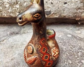 Reprodruction of old peruvian Inca lama conopa