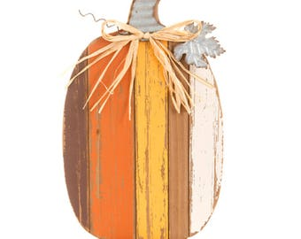 Celebrate the harvest season by placing this fall centerpiece on your dining table. pumpkin centerpiece. Rustic pumpkin
