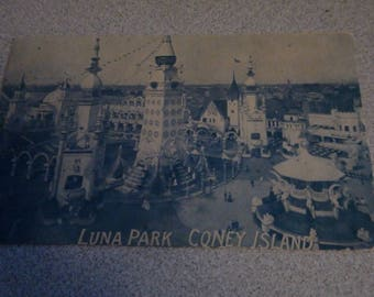 blue tint 1911 postcard of coney island luna park