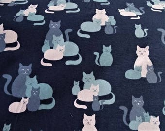 """Fabric cotton jersey printed with """"cats"""" design on blue background"""