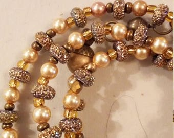 Gold pearl necklace with pave rondelles and antiqued gold spacers