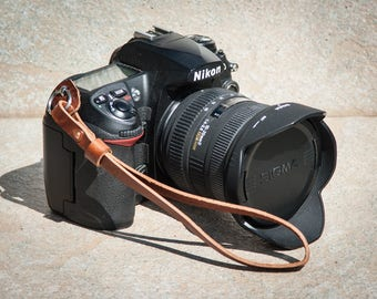Chestnut leather camera hand strap with copper rivet