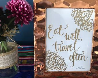 A4 'Eat well travel often' embossed gold bronze quote