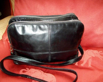 A ladies  vintage French real leather shoulder/cross body bag