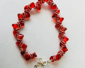 Red cubic zirconia faceted bead bracelet