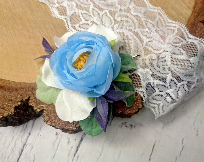 Pastel blue wedding hair pin with white hydrangea and greenery