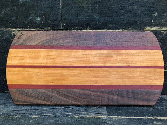 Cutting board made from cherry walnut and purple heart woods