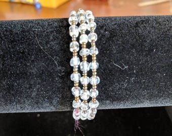 Memory wire bracelet- copper and clear seed beads
