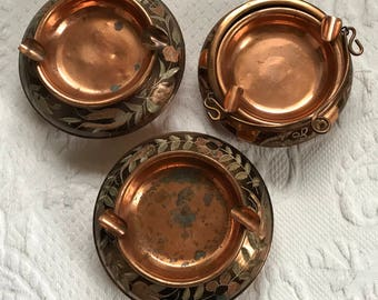 copper ashtrays. 3 copper ashtrays . etched copper . made in Turkey