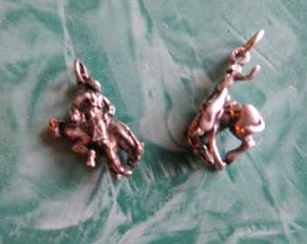 Two Vintage Sterling Silver Cowboy Rodeo Bucking Bronco Charms