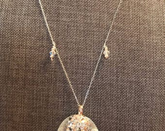 Beautiful silver necklace featuring leaf pendant and crystal dangles